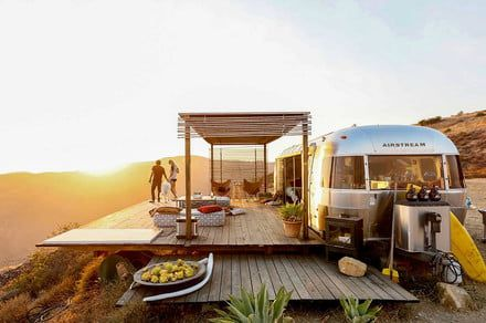 Camp on a cliffside at the edge of the ocean in the Malibu Dream Airstream