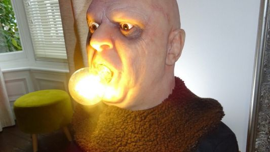 Uncle Fester From THE ADDAMS FAMILY Gets a Life-Size Lamp with a Lightbulb in His Mouth