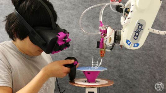 Combining augmented reality, 3D printing and a robotic arm to prototype in real time