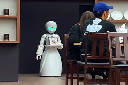 The robot waiters in this Japanese cafe are controlled by people with paralysis