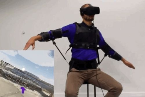 Spread your arms like a bird and control a drone with this exosuit