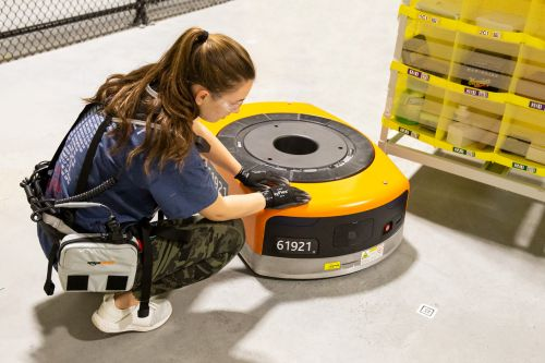 Amazon warehouse workers are getting utility belts that ward off robots