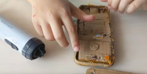 Watch as a cute kid tears down a Pixel he made from cardboard