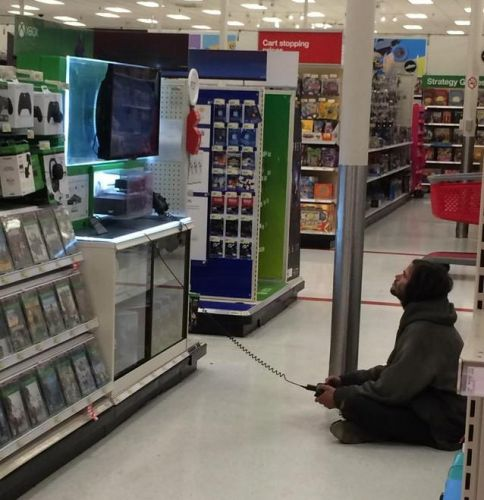 Photo of a Homeless Man Casually Enjoying His Xbox Time at Target Goes Viral on Reddit