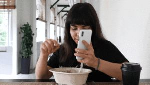Eat food and watch Netflix simultaneously with this fork and spoon-equipped smartphone case