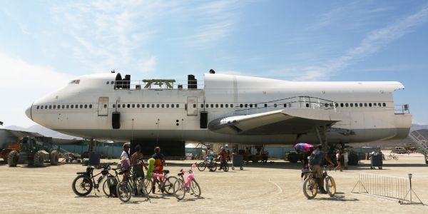 There's a giant plane sitting in the middle of the Nevada desert two weeks after Burning Man - and officials are demanding it be removed