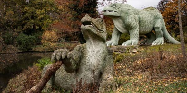 Crystal Palace dinosaurs supported by top hat from Guns N' Roses Slash