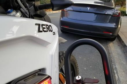 Zero DS police edition electric motorcycle stops a Telsa Model S