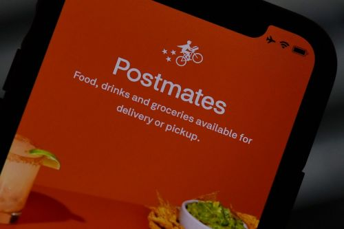 Uber acquires meal delivery service Postmates for $2.65 billion