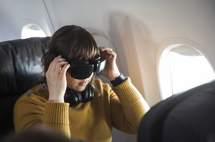 Flying could feel more like going to the movies with VR headsets and headphones