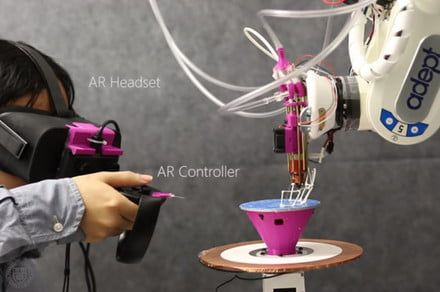 Robotic 3D printer uses augmented reality to fabricate designs as their created