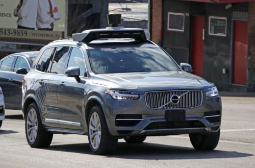 Uber's self-driving car saw pedestrian before fatal crash, but was programmed not to brake