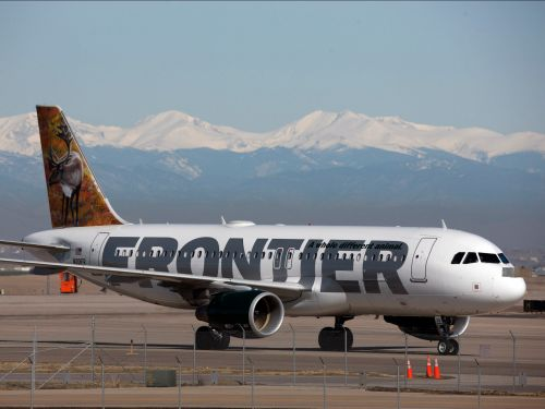 A Frontier Airlines passenger was caught urinating on the seat in front of him after reportedly harassing two female passengers