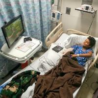 Two charities unite to help hospitalized disabled kids play games
