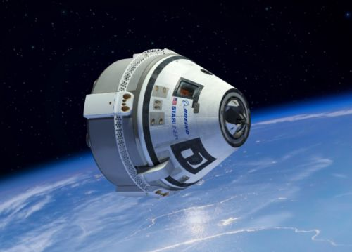NASA swaps out astronauts for first manned flight on Boeing's new ship