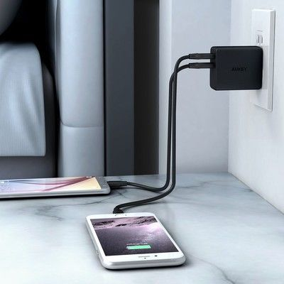 Charge two things with one outlet thanks to this $8 Aukey Wall Charger