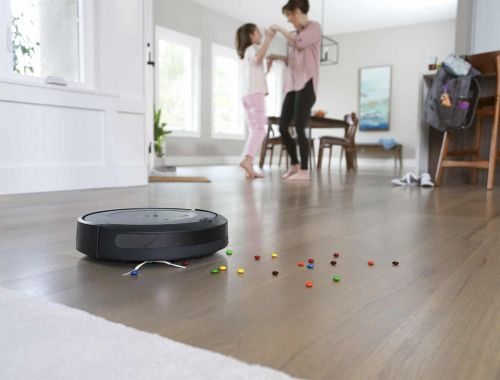 This midrange Roomba adds smarts and empties its own dustbin - CNET